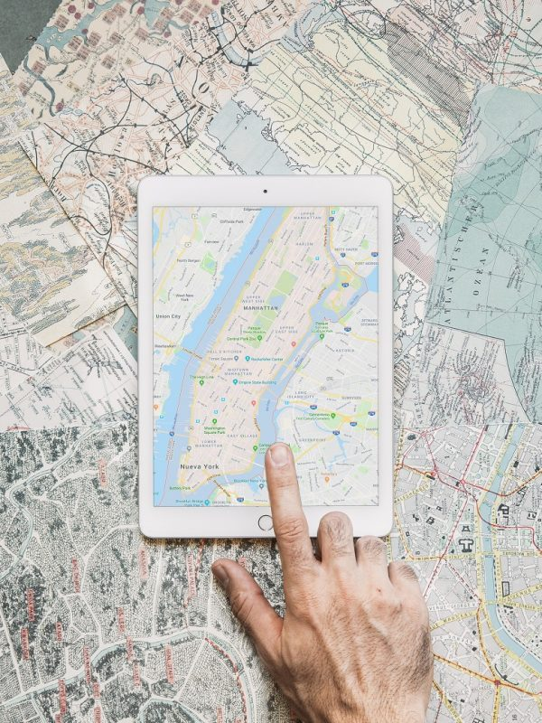 hand-tapping-on-tablet-with-map